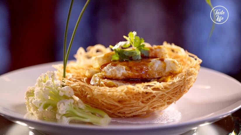 Abalone Over Eggs in Crispy Potato Nest